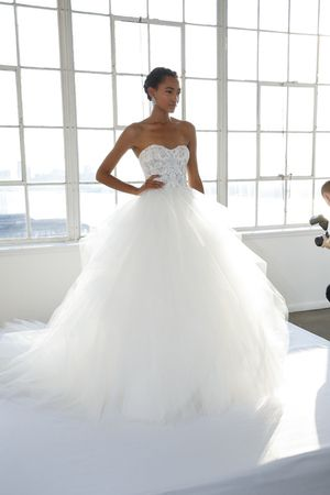 Detailed corseted-top ballgown wedding dress with tiered ruffle skirt by @marchesafashion | Bridal Market Fall 2016
