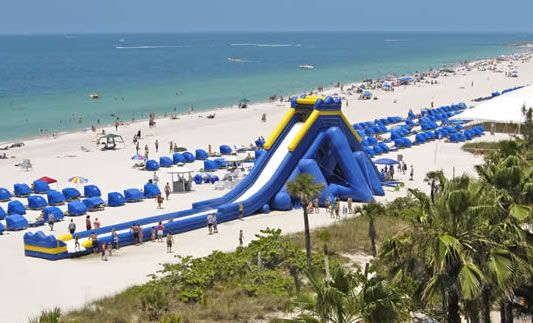 World's largest inflatable slide the Hippo Slide that can be used wet it's great for huge corporate events, large festivals, the beach or lake summer events and is 40' tall, 50' wide X 170' long used wet with huge landing zone at the end.http://allaroundbouncing.com/slides/largest-more.asp