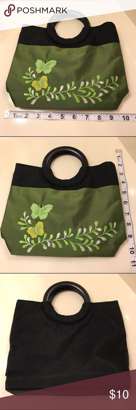 Cute Embroidered Bag Cute embroidered handbag with butterfly design. Chartreuse color in front. Black colored material in back. Plastic handles. 2 open interior pockets. 1 zippered interior pocket. Purchased in Japan. Never used, no issues. Bags
