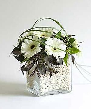 Make a celebration centrepiece - with all the whites, this would be a pretty winter-themed or New Year's party centerpiece! :)
