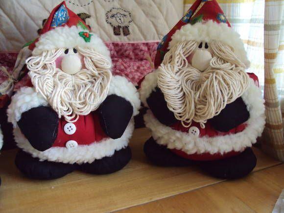 Peso de pota Noel que é um espetáculo feito em tecido de algodão. R$ 35,00
