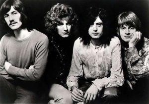 Led Zeppelin  great black and white photo shows contrast  the background is fully black which makes them really stand out