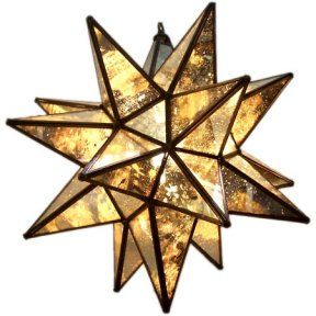 replica of an antique mirrored moravian glass star light with a bronze frame