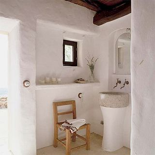 Summer home in Ibiza.  This clay home uses organic accents & neutrals for a clean feel.  Do you see this in a Rising Barn?  Risingbarn.com  #clay #home #wood #bathroom #modern #decor #simple #clean #fresh #organic