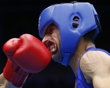 Nordine Oubaali of France (L) fights against Afghanistan's Ajmal Faisal in the men's Fly (52kg) Round of 32 boxing match at the ExCeL venue during the London 2012 Olympic Games July 30, 2012. http://www.PaulFDavis.com/success-speaker (info@PaulFDavis.com)