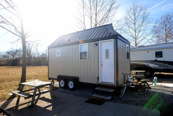 college student living in a $22,000 home built on a 18ft by 71/2 ft flatbed trailer