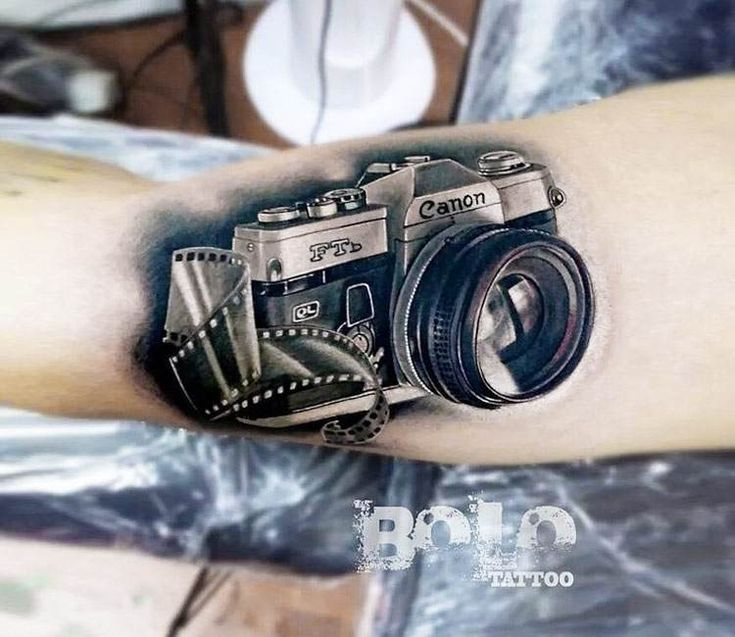 Canon Camera tattoo by Bolo Art Tattoo