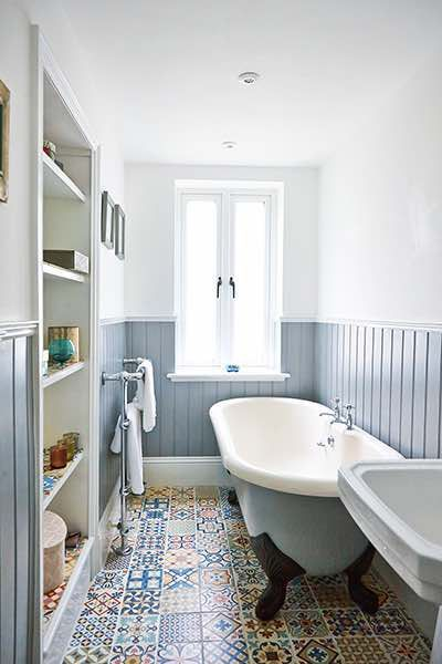 Discover how to turn a windowless bathroom into a light-filled space