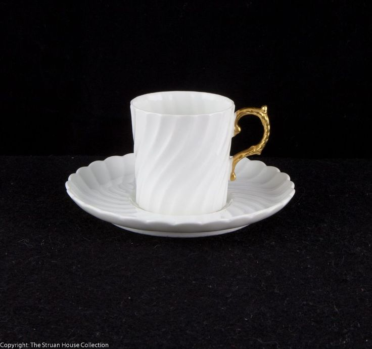 A delightfully simple Aynsley coffee can and saucer in pure white with a gilded handle Both pieces are wrythen-fluted and in immaculate condition, dating late 19C