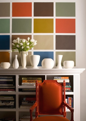 How lovely! Why enjoy just one wall colour when you can have many? :) Lovely, so so lovely; the pattern works so well with the books display and, of course, the pure white vases on top of bookshelf! The awesome tangerine-orange chair makes it all a piece of art! It is not hard to replicate and bring this joyful energy into your home! Great feng shui  for a fire or earth element area of your home (South, Southwest, Northwest or Center) More tips: http://FengShui.About.com