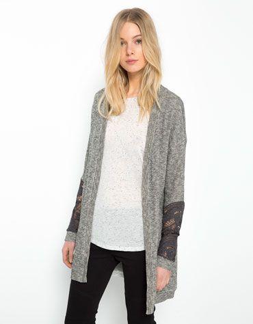 Bershka Polska - Trykotowy sweter Bershka z aplikacjami na rękawach