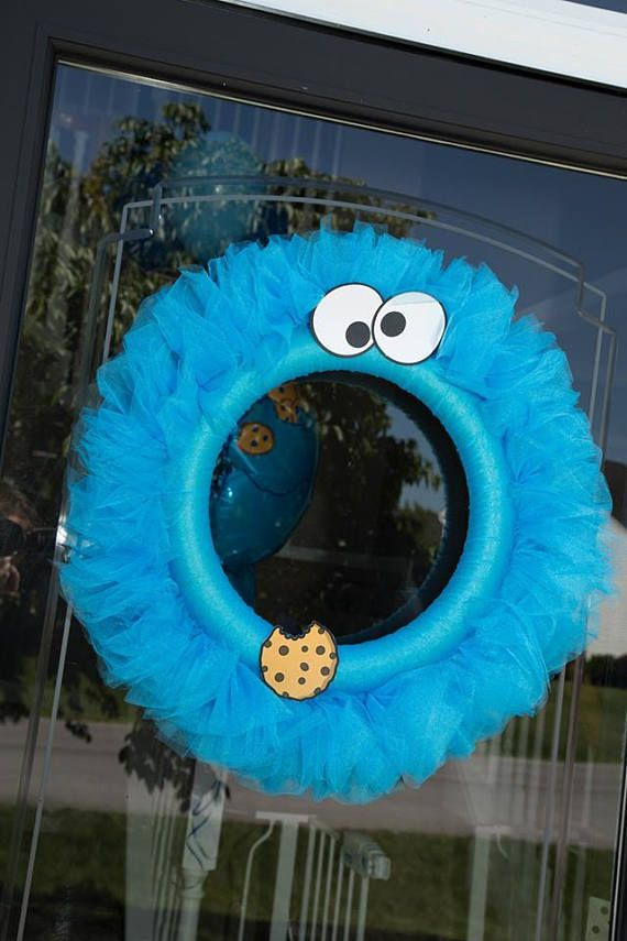 This fun handmade tulle Cookie Monster wreath is a perfect addition for any childs birthday party and even the perfect touch for a baby shower. **This wreath is not meant to be left out in the rain or snow** Please check out my shop to see addition Cookie Monster party items: