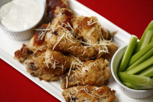 Garlic Butter Parmesan Wings - For hosts and guests who prefer the heat, whisk 1 teaspoon of hot paprika or cayenne pepper into the melted butter.