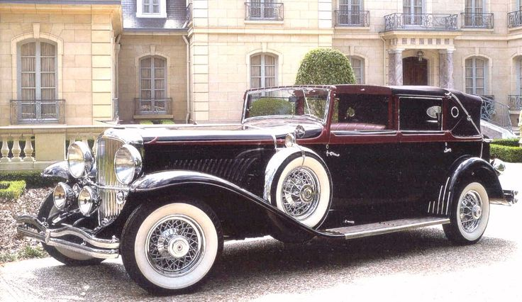1930 Duesenberg J Town Car.  Some prefer Packards, some Cadillacs, but if Jeeves is going to drive you around town, this is the car to do it with.