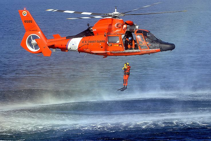 U.S. Coast Guard Petty Officer 1st Class Ty Aweau conducts rescue ...