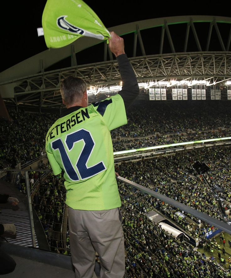 University of Washington football coach Chris Peterson raised the 12 Flag before kickoff of Week 15 at CenturyLink Field.