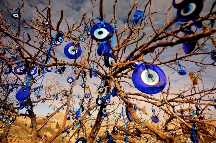 A tree full of Evil Eye ornaments in Cappadocia, Turkey. Photo by Merve Ongoren.
