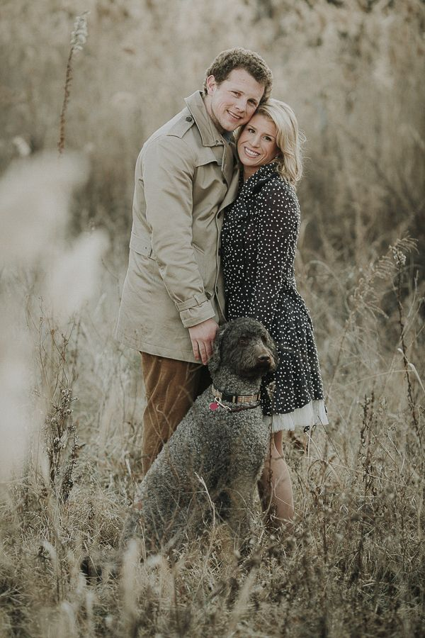 winter engagement photos with Labradoodle, woman wearing cute black coat with white flecks, Kelli Wilke Photography