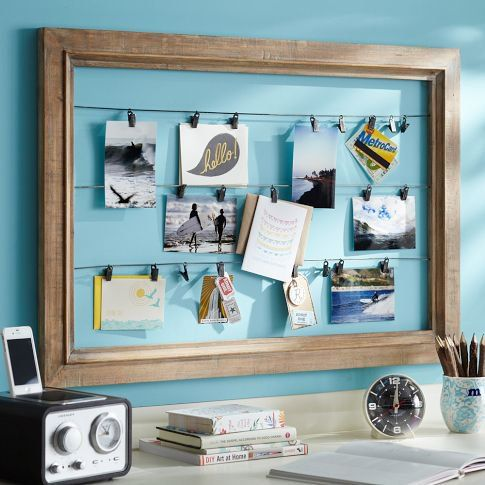 oversized picture frame with photos hanging on wires. Need to do this for prayer cards.