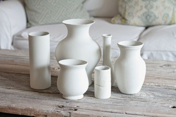 Turn mis-matched vases and jars into a collection using plaster of paris and paint!  Such a cool idea and great use of those jars that don't match your decor!
