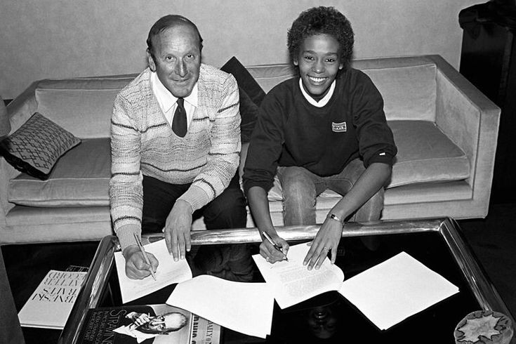 Whitney Houston  Clive Davis Signs Whitney to Arista Records (1983) As a teenager Whitney began performing in nightclubs with her mother and gospel singer, Cissy. After an Arista A&R rep convinced Clive Davis to take interest in Whitney, he promptly offered the budding star a worldwide record contract.