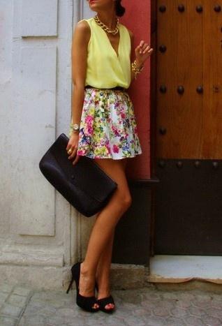 Floral skirt, yellow v- top, black heels.