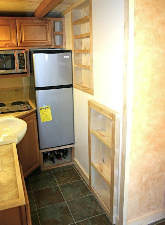 raised frig (easier access) with storage below... shelving inset in framework of wall shared with bathroom, just as i invision my tall and shallow pantry ~ larger tiny house