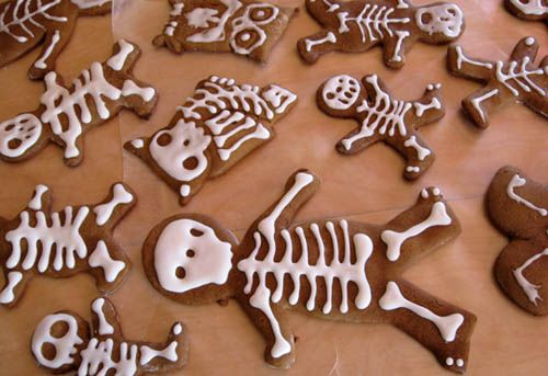 Use gingerbread men cookie cutters and frost in skeleton pattern for fun Halloween cookies