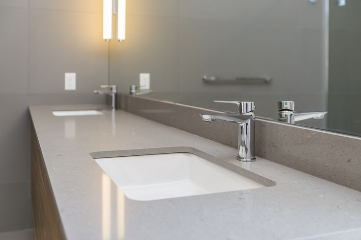 Large double-vanity sink with top-of-the-range taps and basins, plus huge mirror.