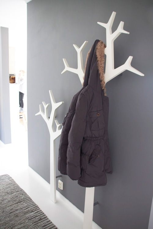 grey wall and tree coat hooks