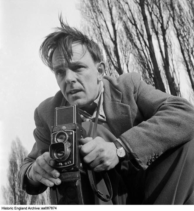 AA087874 An informal portrait of John Gay outdoors using a twin lens reflex camera, 1955. Click for more information, or to search the collection.