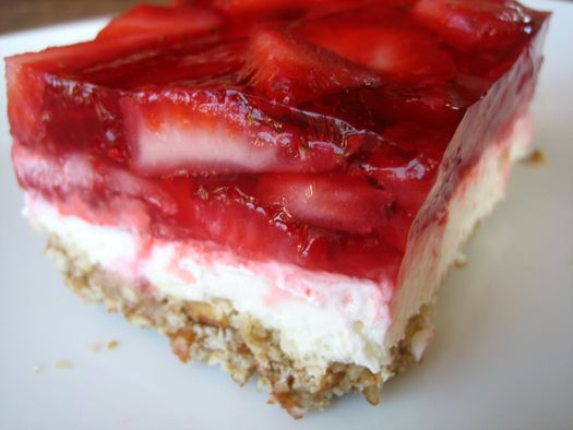 LOVE This!  It's an old family favorite on the Olson side.  The crust consists of crushed pretzels, sugar, and melted butter. On top of that sits a combination of whipped cream cheese and sugar, with Cool Whip folded in. And on top of that, a layer of strawberry jello with fresh sliced strawberries floating throughout.