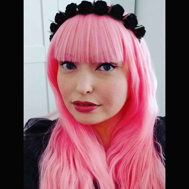 Brenda, so much more than just pretty in pink. Here she is in our 'Rock Chic'... She's even styled it herself with a blunt fringe...