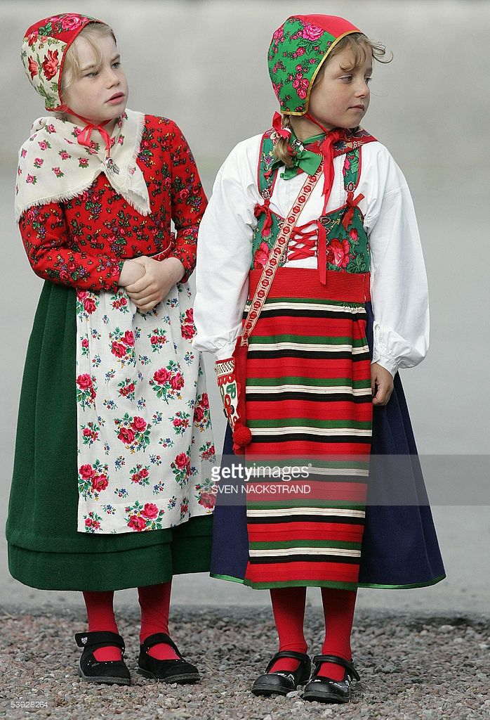 Swedish girls in folk dress waits to great the Swedish Royal family at the Skansen open-air museum in Stockholm 06 June 2005, when the National Day for the first time is celebrated as a national holiday in Sweden. June 6 marks a celebration of Gustav Vasa's 1523 accession to the throne, which ended Danish rule, and the 1809 adoption of a new constitution, kicking off Sweden's democratic tradition. The Swedish flag is the second oldest in the world after the Danish Dannebrogen, dating back…