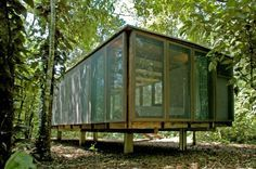 NITSCHE ARQUITETOS This shelter in the wild is built of recycled wood (peroba).  The inside floor and doors are industrialized wood panel coated with cemented plates; the ceiling is a panel sandwich of waterproofed wood and OSB wood based panels.  The exterior is two layers. The skin is made of 2.5 mm x2.5 mm polyethylene mesh, keeping insects out and providing permanent ventilation; the inner skin has a glass closing system with very light supports, making the rooms total transparent.
