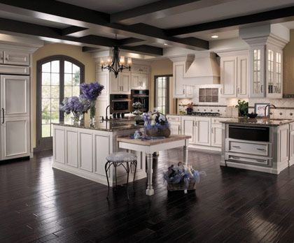 Dark hard wood floor with same color wood beams. Love the lowered baking/prep surface, too... too much dark in there though?