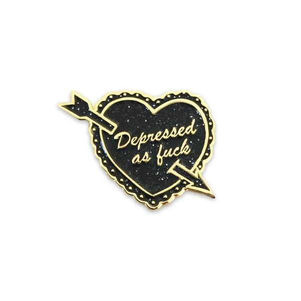 """Tell the world how you really feel with this adorably-emo black heart! Limited Edition, only 50 made! Art by Marisa from Laser Kitten. 1"""" tall, gold metal-plated, soft enamel pin with a butterfly clas"""