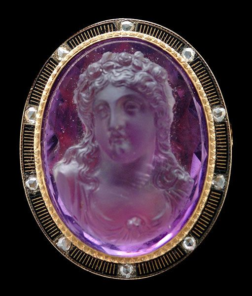 high relief bust of lady finely carved of amethyst quartz, engraved 12 kt. gold collet mount, surrounded by 9 kt. gold rim set with ten old rose cut diamonds, total .30 cts., black enameling, mid to late 19th century, 1-1/2 x 1-1/4 in
