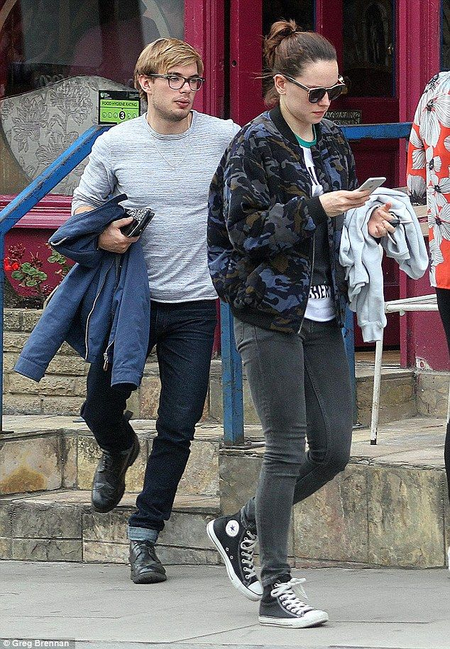 Out and about: Ridley was seen walking a few paces ahead of her beau as she checked update...