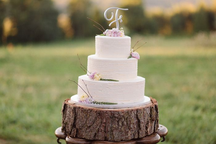 Simple 3 tier wedding cake, white with flower decor