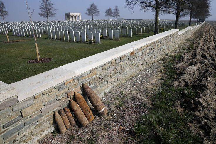 Unexploded shells are lined up along a wall awaiting removal by bomb-disposal experts after a French farmer found them while plowing his fields near the Courcelette British cemetery, the scene of a WWI battlefield in the Somme, on March 12, 2014. (Reuters/Pascal Rossignol)