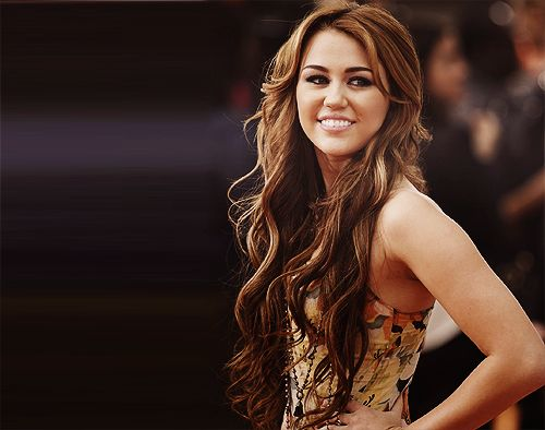 When Miley had long brown hair like this, I modeled my hair after her.   Now, no thank you.