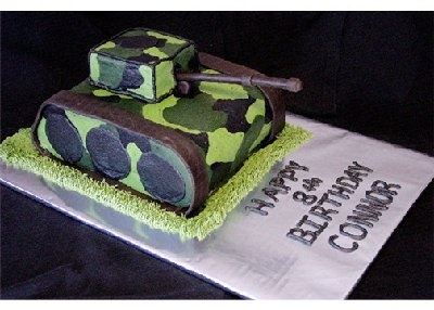 great idea for service personnel or little boy who is into such things.  I would add the little green army men like in Toy Story. via Cake Central