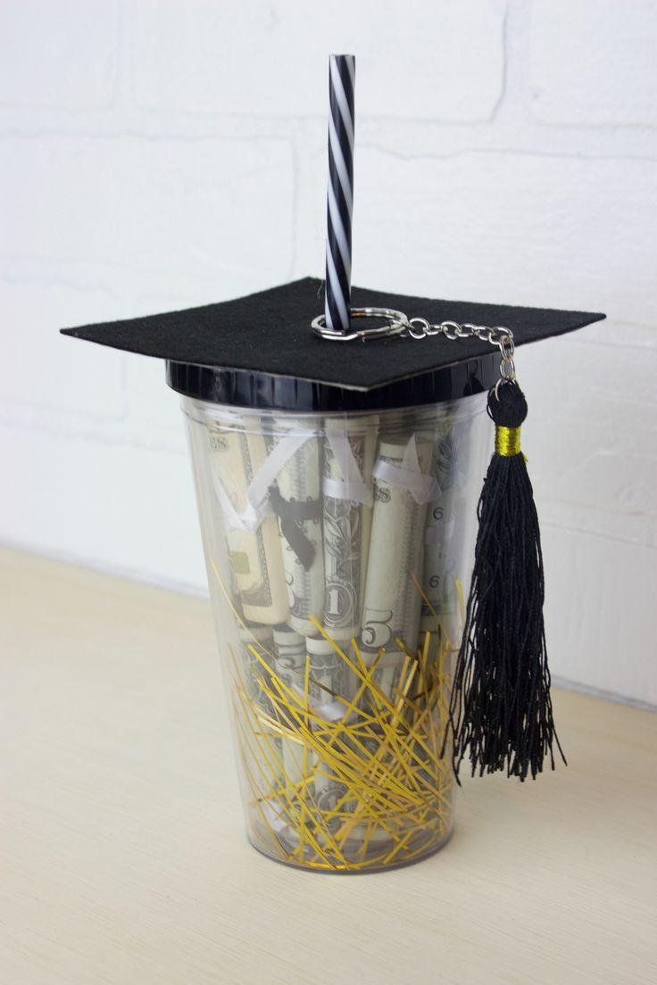That's why today I am sharing this super fun and easy way to give money as a grad gift. It is a DIY Graduation Gift in a cup!