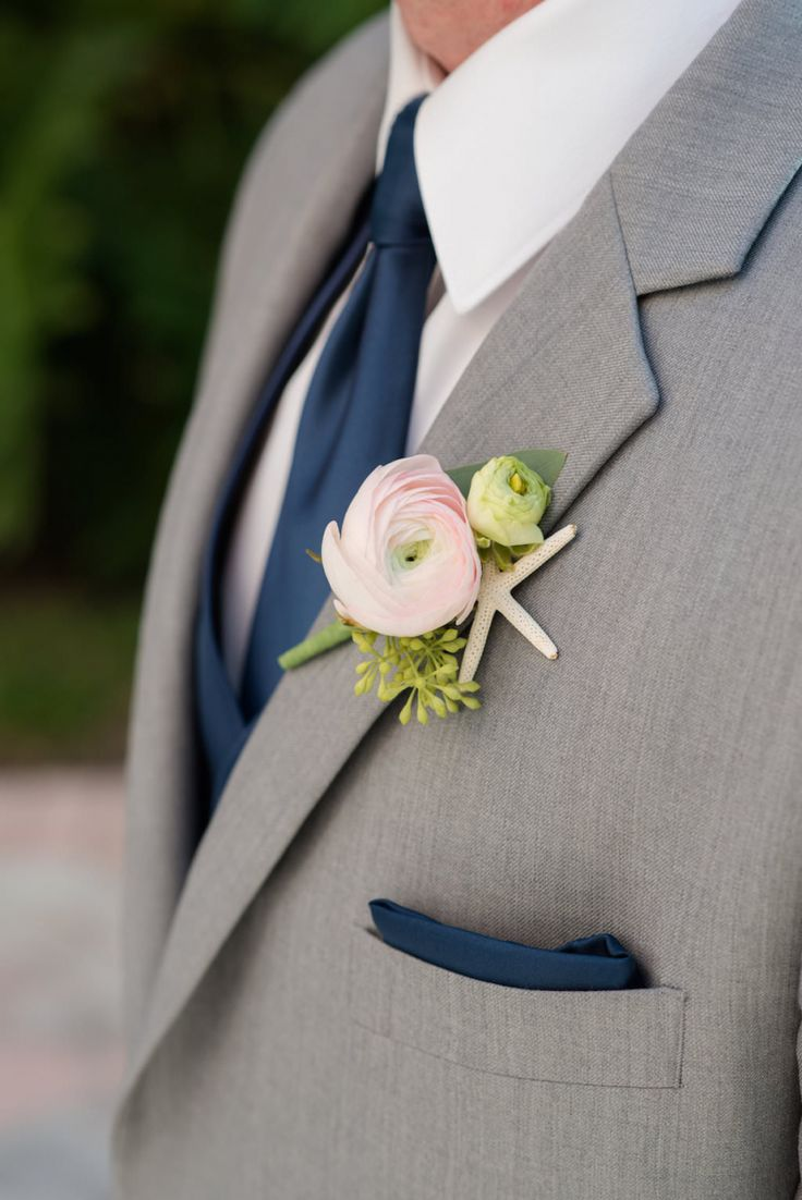Nautical Inspired Groom Boutonniere with Pink flower and Starfish, wearing Gray Suit with Navy Blue Tie and Pocket Square