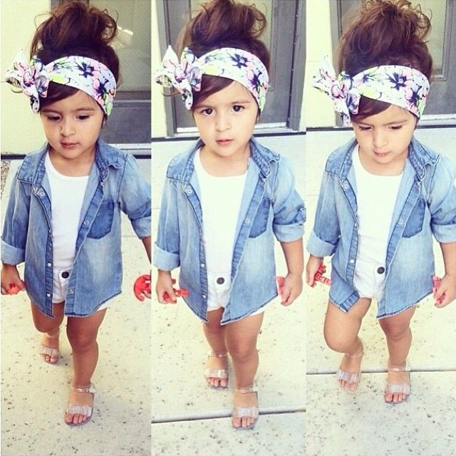This cute little girl wears a denim jacket with a nice flower headband