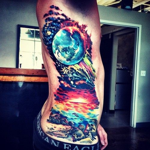 Wow, space, sky, ocean, rib tattoo. this is art. this is beautiful.