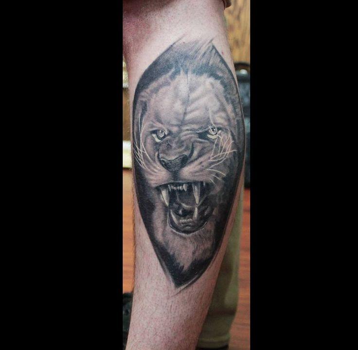 242cc3dca54b8 lion tattoo calf .