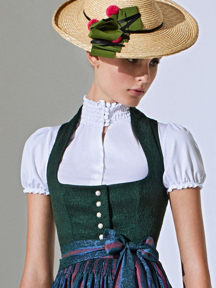 This is pretty and modest at the same time. Green Dirndl with stand-up collar…