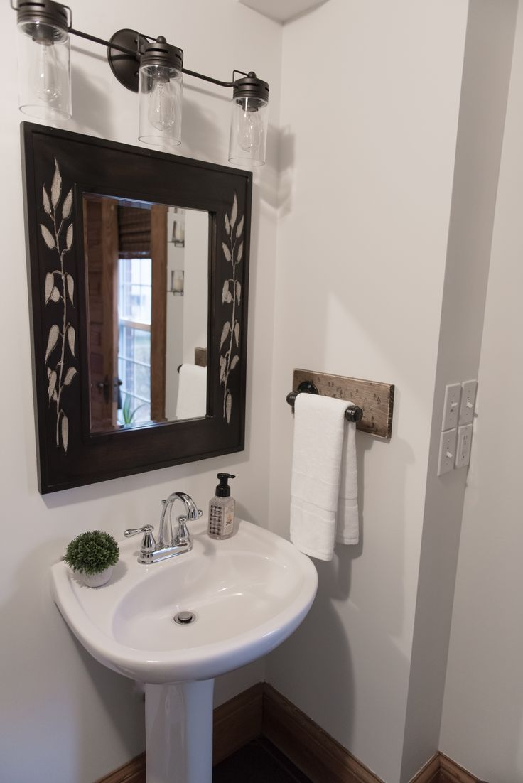 Our rustic hand towel bar adds such character into your powder room!